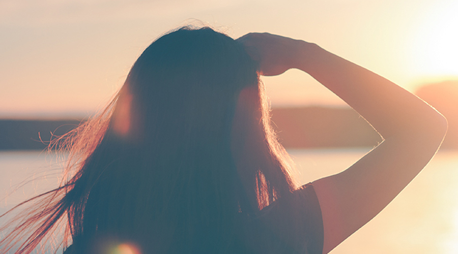 Image of woman looking of sunset